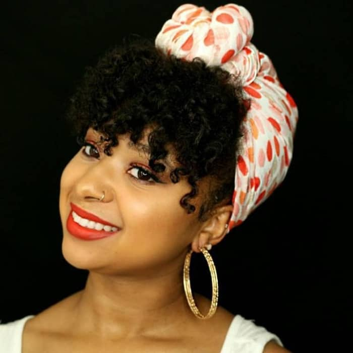 High top knotted hair style for those thinking of wearing a scarf!
