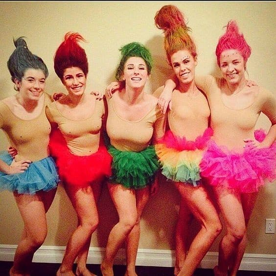 There are so many group costume ideas for the 2020 Halloween season, it's hard to keep up. However, if you're looking to dress in something easy, homemade. Check out this Trolls Halloween Costume look.
