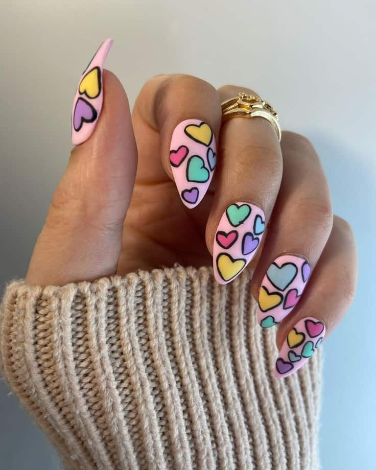 Colourful heart nail designs. 21 Cute Valentine's Day Nail Design Ideas to Shine The most romantic day of the year is approaching. Yes, we are talking about Valentine's day. Apart from all these sweet and meticulous dressing, valentine's day nail art is essential.