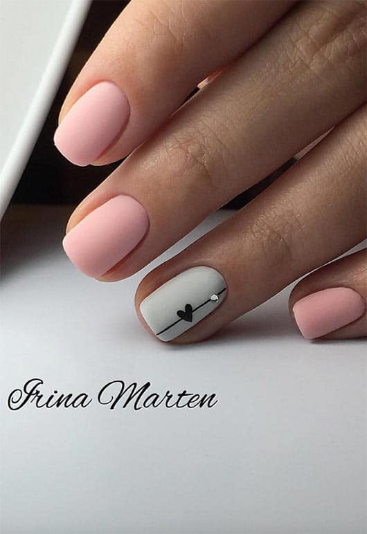 Minimalist manicures are fun and cute especially when a small heart and a jewel come into play. This nail art for short nails can work with nearly any color combination, but it would still look soft and sweet. It makes great use of the space offered by shorter nails without covering every inch in detailed designs.