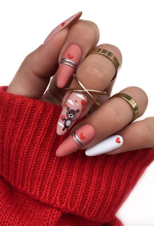 A soft little teddy bear is just lovely on V-Day, and you can draw it on all by yourself by creating small circles and lines. This cute nail design is extremely trendy for Valentine's day.